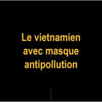 G Le vietnamien avec masque antipollution
